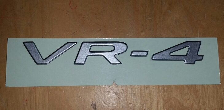 Mitsubishi OEM 3000GT Emblem VR-4 Light Gray